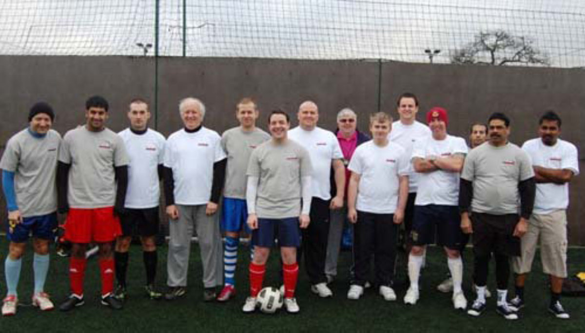 flowstore football team at fundraising event